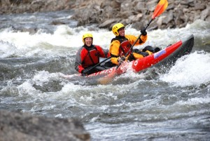 tandem kayaking down clearwater river