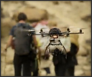 Quad rotor Copter camera filming mountain climbers